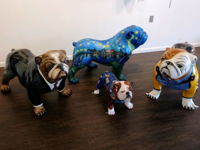 Seven bulldogs have been adopted by local businesses from the Jacksonville/Onslow Council of the Arts with many more on the way in the upcoming year.
