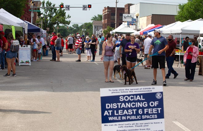 Daily Express file photo from the 2020 Red, White and Blue Festival at downtown Kirksville, including social distancing signage.