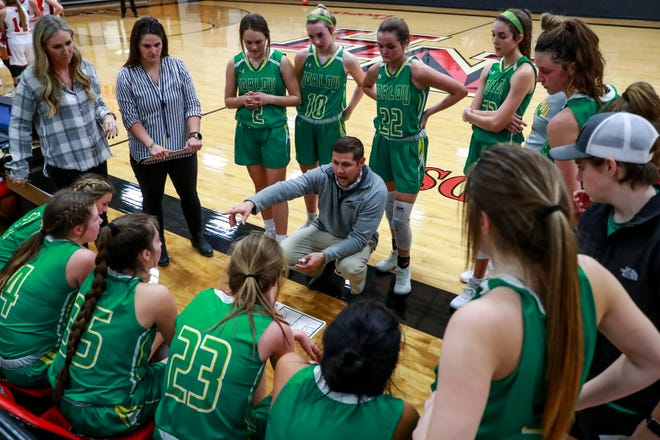Idalou coach Tyler Helms talks to his players during a timeout against New Home on Tuesday, Nov. 17, 2020, at New Home High School in New Home, Texas.