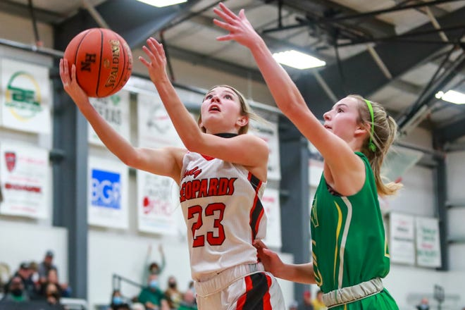 New Home's Addie Stewart (23) shoots a layup during a nondistrict game Tuesday against Idalou at New Home High School in New Home, Texas.
