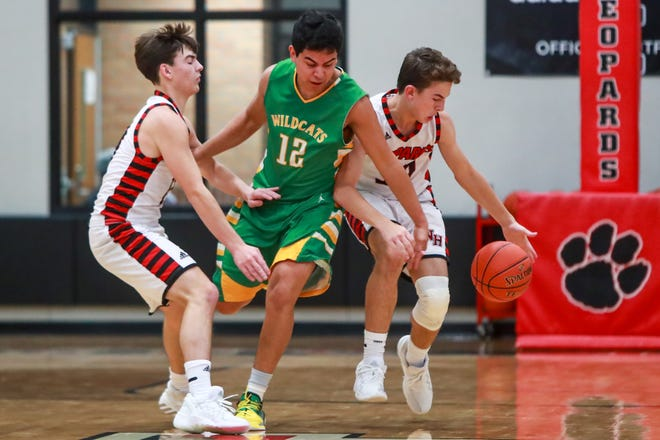 New Home's Reagan Fiedler (3) steals the ball from Idalou's Austin Flores (12) on Tuesday, Nov. 17, 2020, at New Home High School in New Home, Texas.