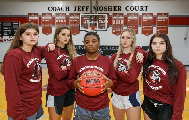 From left, Santa Fe's Shea Quintana, Kassidy Jones, Omega Payton, Courtni Demorest, and Kirsten Grindel lead the Hawks as the girls basketball season gets underway.
