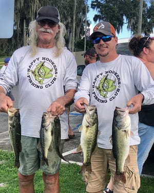 Paul Scouras, left, and Bruce Anderson had 10.40 pounds to win the Happy Hookers Bass Club tournament Nov. 14 on Eagle Lake.