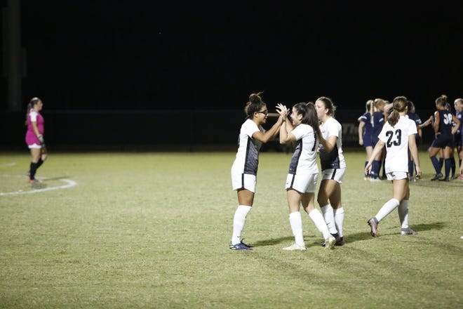 Aisha Solorzano (left) and Naira Lopez celebrate after Solorzano's goal to send Southeastern to a 1-0 win over South Carolina-Beaufort on Tuesday night. The win sends the Fire to their fifth consecutive Sun Conference Women's Soccer Tournament Final.