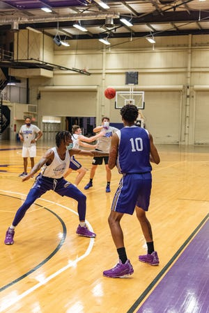 The Western Illinois mens basketball team participates in a drill during practice earlier this fall.