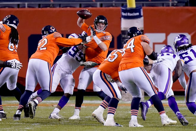 Chicago Bears quarterback Nick Foles is hit by Minnesota Vikings defensive end Ifeadi Odenigbo (95) during the second half of an NFL football game Monday, Nov. 16, 2020, in Chicago. Foles was injured on the play and left the game on a cart. [AP Photo/Nam Y. Huh]