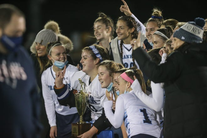 Franklin poses with the Hockomock League Cup after defeating King Philip at the Beaver Street Turf Field in Franklin on Nov. 17.