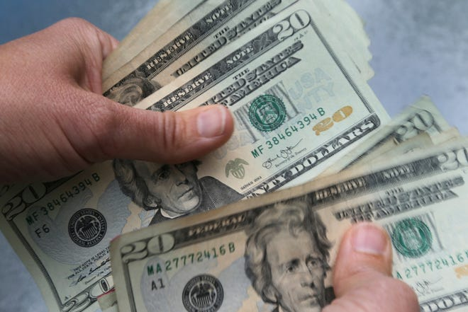 Twenty dollar bills are counted in North Andover. [AP File Photo/Elise Amendola]