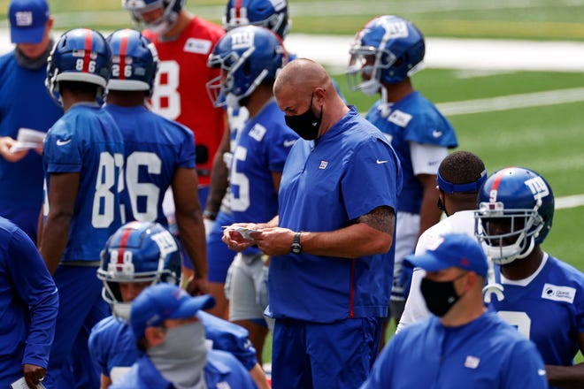 New York Giants offensive line coach Marc Colombo looks on during a practice at the team's training camp in East Rutherford, N.J.
