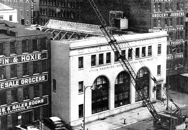In 1958, the Observer-Dispatch added a third floor extending to Catherine Street to its building on Oriskany Street. The building was erected in 1915 with a front entrance on Catherine Street and a rear loading dock facing the old Erie Canal. The canal was abandoned in the late 1920s, filled in, paved and named Oriskany Street. So in 1930, the newspaper moved to a new front entrance to face Oriskany Street. It was three stories high and dominated by three large, distinctive, round-arched windows. It did not, however, extend to Catherine Street. After 1958, it did. The newspaper's neighbors, at the time, were wholesale grocers Griffin & Hoxie (on the left and today the newspaper's employee parking lot) and Field & Start (on the right and today a parking lot facing John Street for employees and visitors).