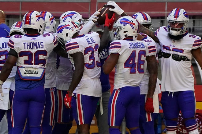 The Buffalo Bills huddle prior to Sunday's game against the Arizona Cardinals.