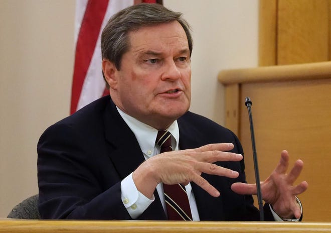 Toyota of Portsmouth owner Jim Boyle testifies during a previous trial in his suit against the city at Rockingham County Superior Court. Boyle is now asking a judge to order the city to put $2 million in escrow, to restore his dealership property to its condition before a city sewer line was installed, and monthly rent for the sewer pipe traversing his Greenleaf Avenue land.