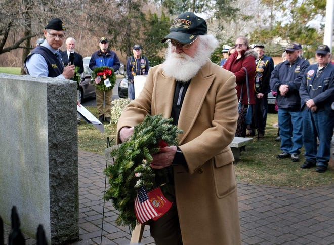 In this December 2018 photo, U.S. Marine veteran Charles Skinner lays a remembrance wreath in memory of those who served and are serving in the U.S. Marine Corps during the Wreaths Across America ceremony at Albacore Park in Portsmouth.