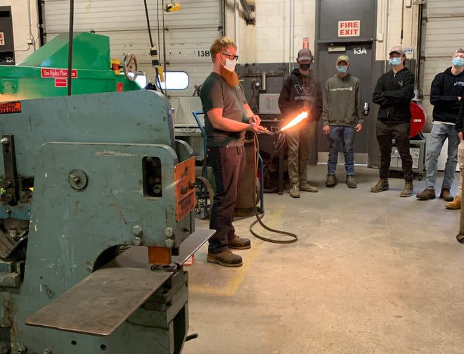Seacoast School of Technology welding instructor Joseph Biladeau demonstrates how to set a neutral flame for welding with the Oxy-Fuel process.