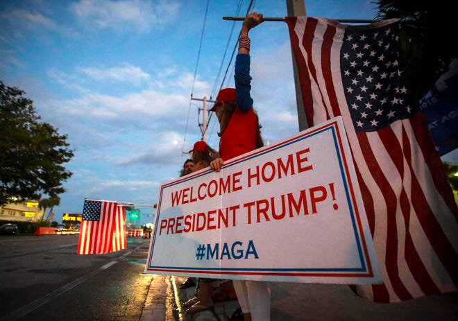 Supporters of President Donald Trump line Southern Boulevard in 2018 for his return to Palm Beach for Thanksgiving at Mar-a-Lago.