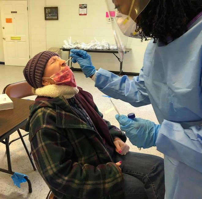A Chesterfield Health Department nurse conducts a nasopharyngeal swab COVID-19 test on Progress-Index reporter Kristi K. Higgins at Walmsley Boulevard United Methodist Church in Richmond Tuesday, Nov. 17, 2020.