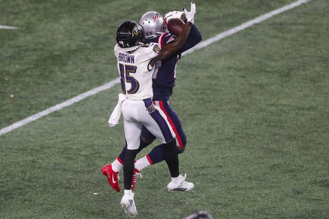Patriots cornerback J.C. Jackson intercepts a pass during the first half of Sunday's game against the Baltimore Ravens at Gillette Stadium.