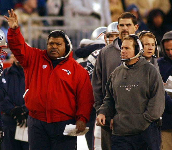 Romeo Crennel and Bill Belichick work together on the sideline during a 2003 Patriots game. [the providence journal, file / bob breidenbach]