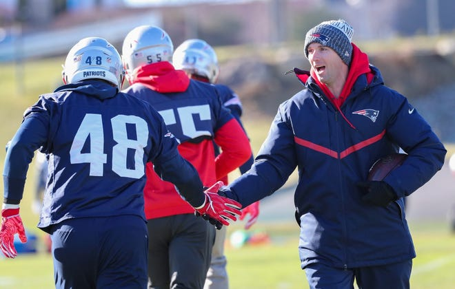 Jack Easterby, who was the Patriots character coach, greets players during a workout during the 2018 season.