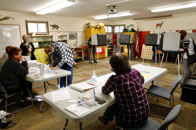 Voters fill out their ballots on Tuesday, Nov. 3, 2020, at the Boone County Conservation District polling place in Belvidere. The final election results were confirmed Nov. 18, 2020, after eligible mail-in ballots were counted.