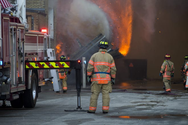 Rockford firefighters battle a large blaze in the 2500 block of North Main Street on Saturday, Oct. 24, 2020, in Rockford. The fire was reported at about 5:15 a.m. at the former Atwood industrial building, a vacant facility that fire officials say has long been slated for demolition.