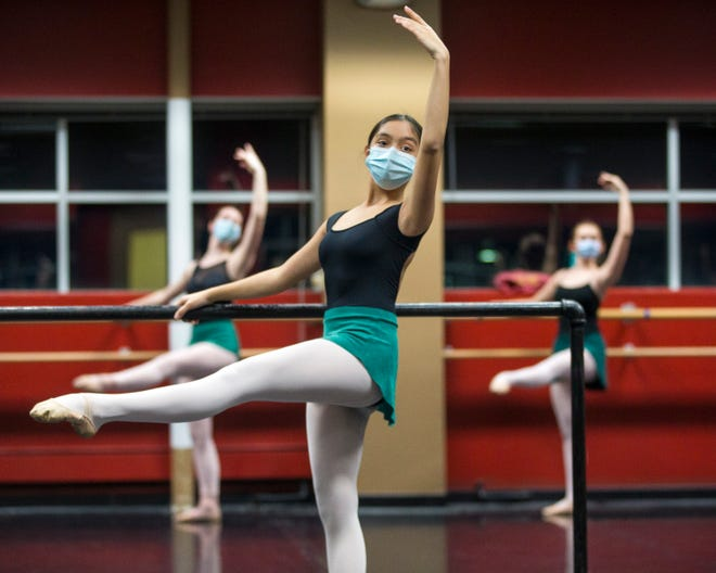 Mia Krystal Soto Rivera, 12, and other dancers practice during Interim School Director Maria Castello's company-level ballet class at Rockford Dance Company studios on Tuesday, Nov. 17, 2020, in Rockford.