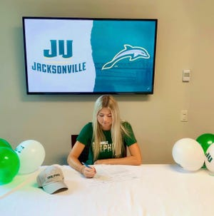 Ashley Huffman signs with Jacksonville University for a golf scholarship.