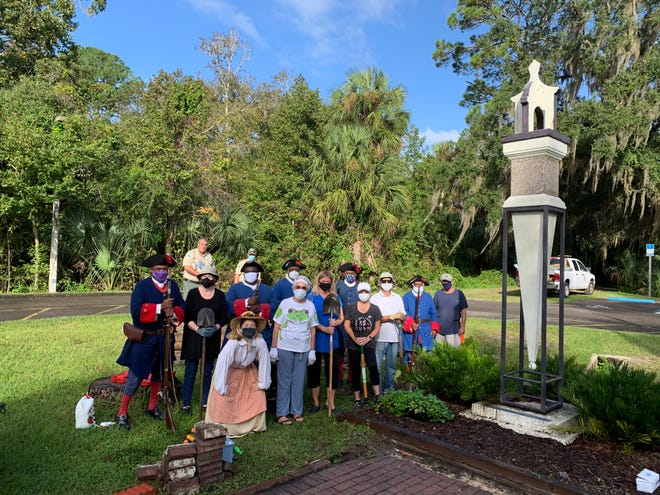 Members of the Maria Jefferson Chapter, Florida State Society Daughters of the American Revolution, and the Fort Mose Historical Society tend to the museum entrance at Fort Mose Historic State Park.