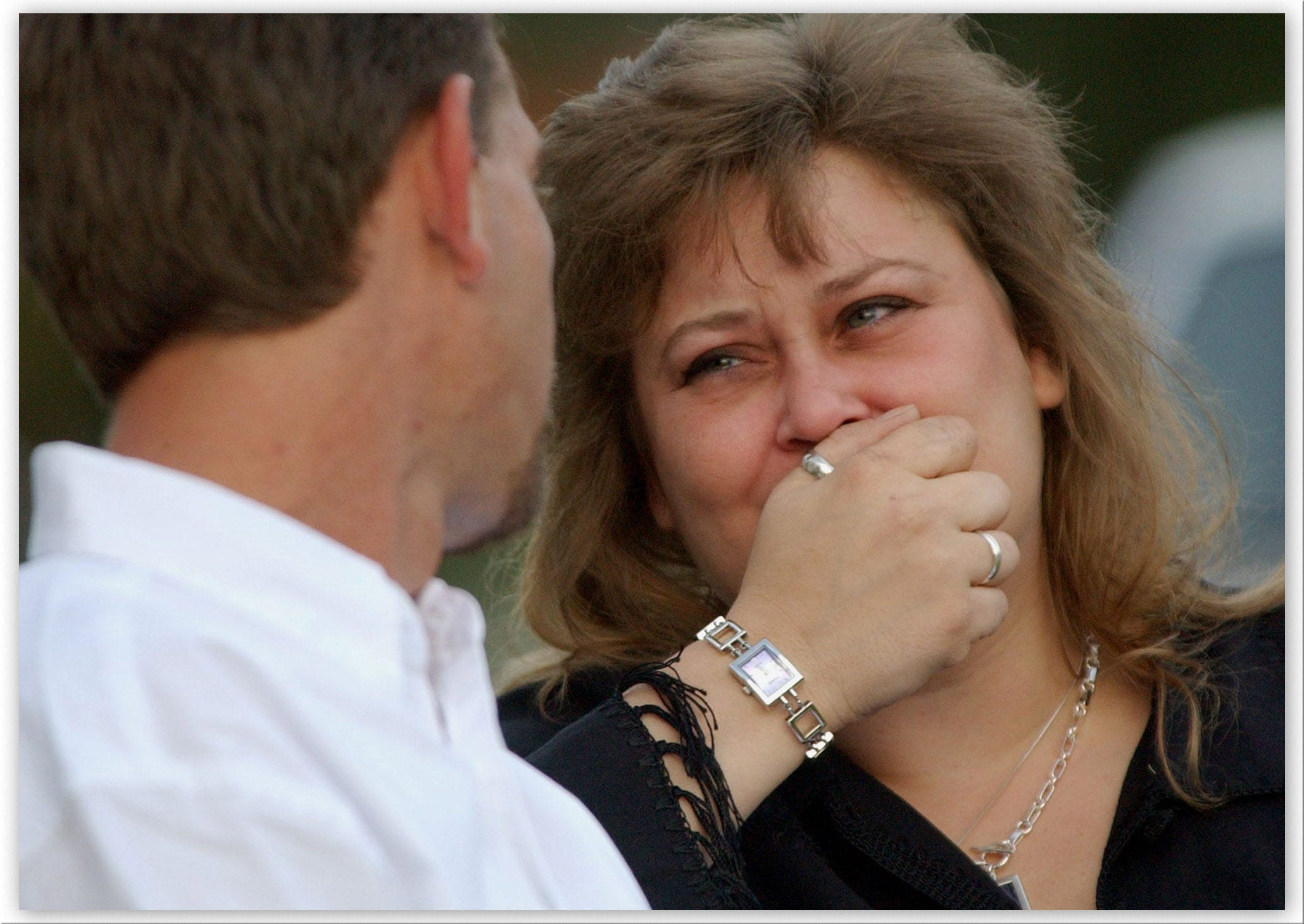 Susan Schorpen, right, mother of Carlie Brucia, cries as her husband Steve Kansler, Carlie's stepfather, comforts her during a memorial service for the 11-year-old Feb. 10, 2004 outside the Central Church of Christ in Sarasota, Fla.  Carlie's body was found behind the church.