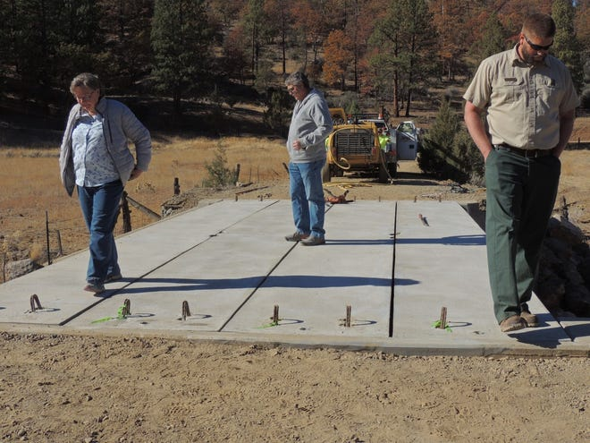 Former supervisor Grace Bennett, District 5 Supervisor Ray Haupt, and Ben Haupt, Timber Management Officer for Klamath National Forest check out the new Moffet Creek Bridge.