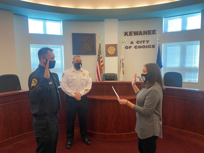 James Mock, left, is sworn in as a new Kewanee Police officer Tuesday by city employee Beth Kelley as new chief Nicholas Welgat observes.