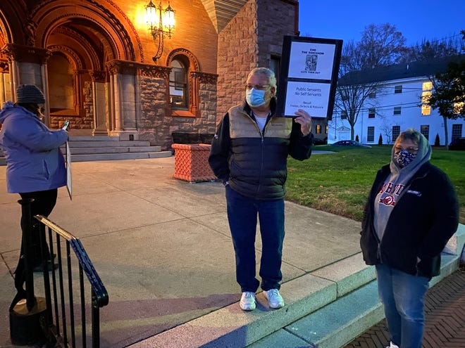 A protester at Fairhaven Town Hall on Monday