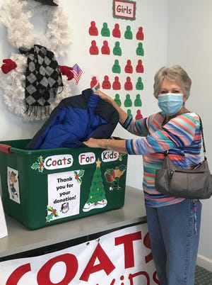 Coats for Kids kicked off its 26th season on Nov. 2. Linda Watson is pictured making her donation to the drop box. You may make your donation of a new coat through Dec. 18 at the office of Flemming Chriropractic, 3601 Trent Road, New Bern. The coat may be any size but must be new with price tag attached. Coats will be distributed by the Hope Family Resource Center to local disadvantaged children. [CONTRIBUTED PHOTO]