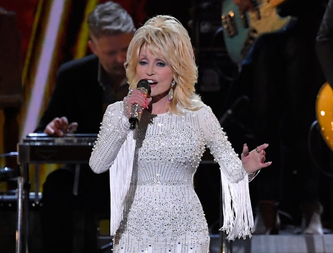 In this Nov. 13, 2019 file photo, Dolly Parton performs at the 53rd annual CMA Awards in Nashville, Tenn.