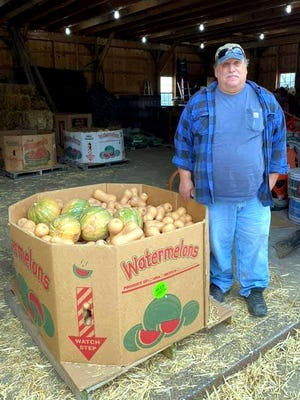Dave Rota, of Rota Springs Farm in Sterling, donated a large number of butternut squash for the Great Lancaster holiday baskets.