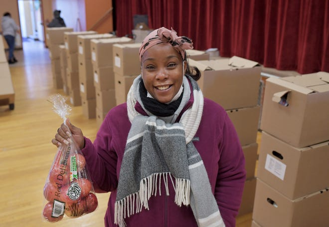 WORCESTER - Anika Romney works with Yes We Care at Belmont AME Zion Church, 55 Illinois St. She is pictured with boxes of food from the USDA on Wednesday, November 18, 2020.
