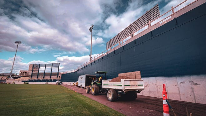 "The 22-foot high blue wall in right field is a Worcester version of Fenway Park's famed ""Green Monster"" and was necessitated by a 30-foot drop in topography at the site in the Canal District."