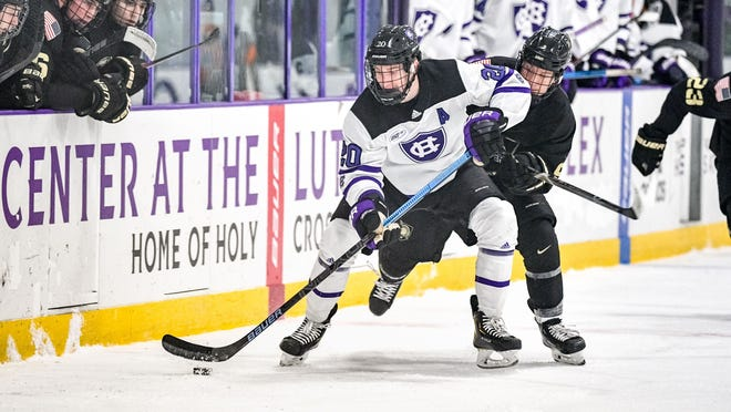 Holy Cross men's hockey forward Logan Ferguson and the Crusaders will open the 2020-21 season Thursday at the Hart Center.