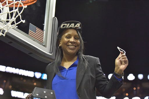 Fayetteville State women's basketball coach Serena King-Coleman celebrates the Broncos' triumph in the 2019-20 CIAA tournament finals in Charlotte. {Photo courtesy of Fayetteville State Athletics}