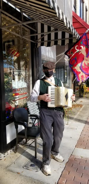 Squeezebox artist David Nikkel is among those performing in downtown Fayetteville.