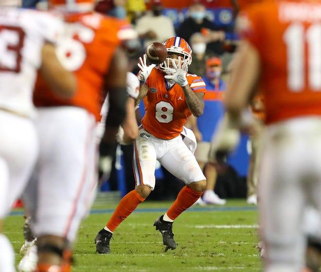 Florida receiver Trevon Grimes (8) catches a pass Saturday against Arkansas at Ben Hill Griffin Stadium.