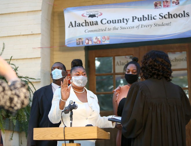 Newly elected Alachua County School Board member Diyonne McGraw is sworn in during a ceremony Nov. 17 for school board members held outside the headquarters of the school board in Gainesville.