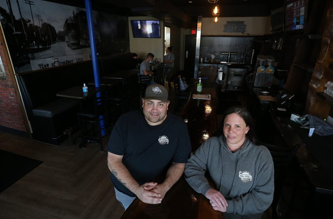 Sarah and Bryan Smink, owners of Blu-Willy's, stand inside their restaurant, 3985 Broadway in Grove City. Blu-Willy's has reopened for carryout from 3 to 9 p.m. seven days a week. The restaurant was damaged by a fire in April.