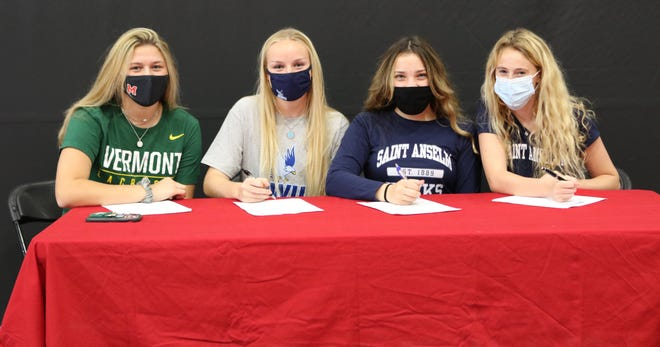 Marblehead High School senior athletes Maddie Erskine, Josie Poulin, Elzabeth Driscoll and Anna Rigby, from left, are shown together during a special ceremony at the high school last week declaring their college choice on National Letter of Intent College Signing Day.