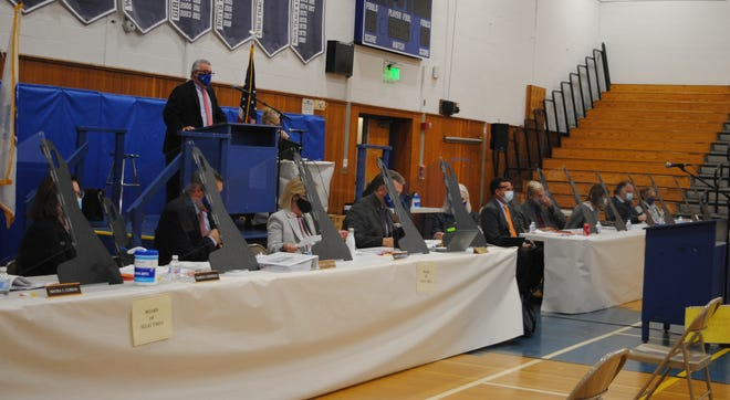 Town administration, including members of the Board of Selectmen and the Advisory Board, are separated by partitions at their designated tables for special Town Meeting on Nov. 16.