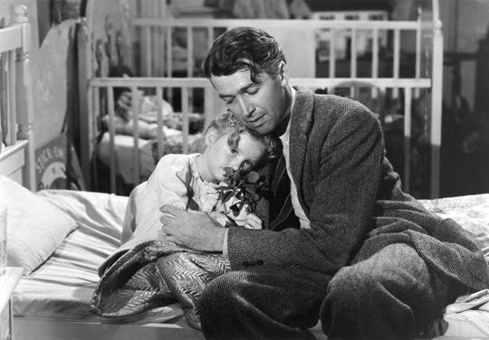 """Karolyn Grimes, left, with her screen dad Jimmy Stewart in """"It's a Wonderful Life."""""""