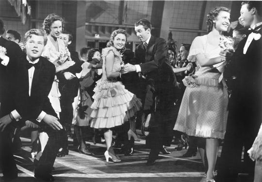 """Donna Reed, center left, and Jimmy Stewart, center right, in the famous dance scene (watch out for that retractable floor) in """"It's a Wonderful Life."""""""