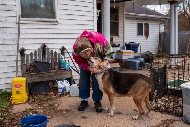 Tracey Lee cuddles her dog Suzy on Tuesday, Nov. 17, 2020 at ROAR Animal Sanctuary in Battle Creek, Mich. Community members are rallying together to help Battle Creek resident Tracy Lee put a new roof on the 501c3 animal sanctuary she runs out of her home.
