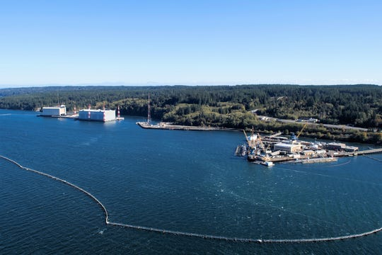 The waterfront at Naval Base Kitsap-Bangor includes the Delta Pier, at right, home to eight of the nation's fleet of 14 ballistic missile submarines. How a tsunami would impact Hood Canal and Puget Sound is the subject of a just-released study by the state's Department of Natural Resources.