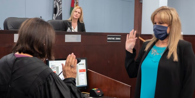 Newly elected Brevard County Commission Chair Rita Pritchett was sworn in Tuesday for her second four-year term as a county commissioner by 18th Judicial Circuit Chief Judge Lisa Davidson. Looking on is newly elected County Commission Vice Chair Kristine Zonka.